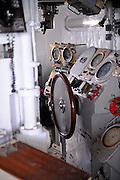 Wheel and instrument panel on the bridge of the USS Missouri. Battleship Missouri Memorial, Pearl Harbour, Hawaii RIGHTS MANAGED LICENSE AVAILABLE FROM www.PhotoLibrary.com