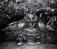 William Rickets Sanctuary - Black and white photo art print of Sculpture of an Aboriginal woman  in the deep woodland of the Dandenon Mountain near Melbourne Australia. Taken 1993 by Paul Williams,