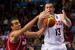 Kevin Love of USA vs Macram Ben Romdhane of Tunisia (L) during  the Preliminary Round - Group B basketball match between National teams of USA and Tunisia at 2010 FIBA World Championships on September 2, 2010 at Abdi Ipekci Arena in Istanbul, Turkey. (Photo By Vid Ponikvar / Sportida.com)