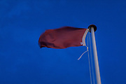 June 2, 2015 - Hastings, England, UK - Coastal employees have raised a red flag on the coast of Hastings, a sign that always arises when the weather is bad. Swimming is prohibited in Hastings, at least until early July. (Credit Image: © Vedat Xhymshiti/ZUMA Wire)