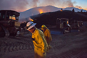 Firefighter set in for a night monitoring the Pocket Fire near Geyser Peak in Northern California. October 13, 2017. The Northern California wildfires of 2017 were a series of late-season fires driven by local wind events that reached hurricane force.