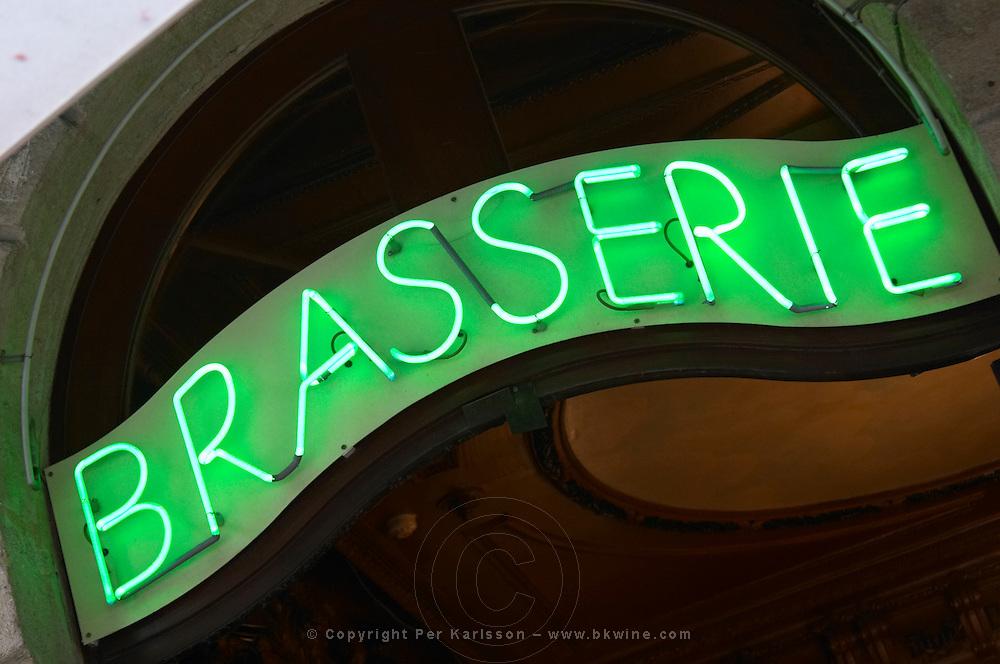 Restaurant. Neon sign saying Brasserie. Bordeaux city, Aquitaine, Gironde, France