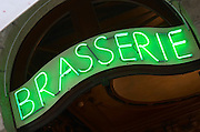 Restaurant. Neon sign saying Brasserie. Bordeaux city, Aquitaine, Gironde, France