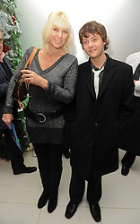 LINZI DREW and her son actor TYGER DREW-HONEY at the launch of the English National Ballet's Christmas season 2009 held at the St.Martin;s Lane Hotel, London on 15th December 2009.