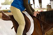 Mature senior riding a horse.