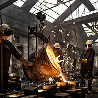 Pouring molten iron into moulds in an Iron Foundry in halifax , West Yorkshire