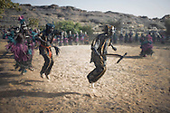 A group of men perform traditional Dogon dances, Endelou, Dogon country, Mali.