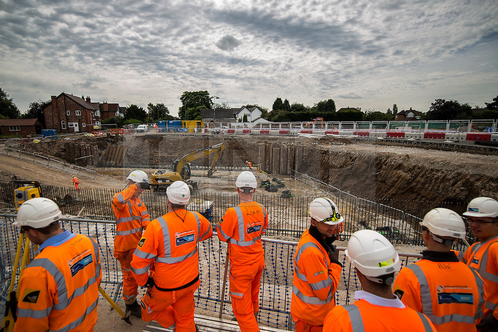 © Licensed to London News Pictures . 05/08/2016 . Cheshire , UK . Workers looking over the A6 relief road construction site , near to Manchester Airport , ahead of Chris Grayling's first visit to the North West since he was appointed Transport Secretary . Photo credit : Joel Goodman/LNP