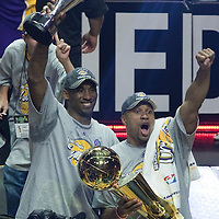 14 June 2009: Kobe Bryant of the Los Angeles Lakers and Derek Fisher pose with the MVP and the Larry O'Brien Championship Trophy as they celebrate after game 5 of the 2009 NBA Finals won 99-86 by the Los Angeles Lakers over the Orlando Magic at Amway Arena, in Orlando, Florida, USA. Kobe Bryant scores 30 points and leads the Lakers to15th Championship.