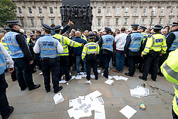© Licensed to London News Pictures. 07/10/2017. London, UK. Demonstrators take part in a march against extremism organised by the 'Football Lads Alliance' (FLA) in central London. Photo credit : Tom Nicholson/LNP