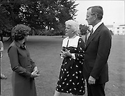 1983-07-05.5th July 1983.05-07-1983.07-05-83..Photographed at US Embassy Residence, Dublin..Bushes on the lawn:..George Bush, US Vice President, with wife, Barbara, chatting with guest in the grounds of the US Embassy  Residence.