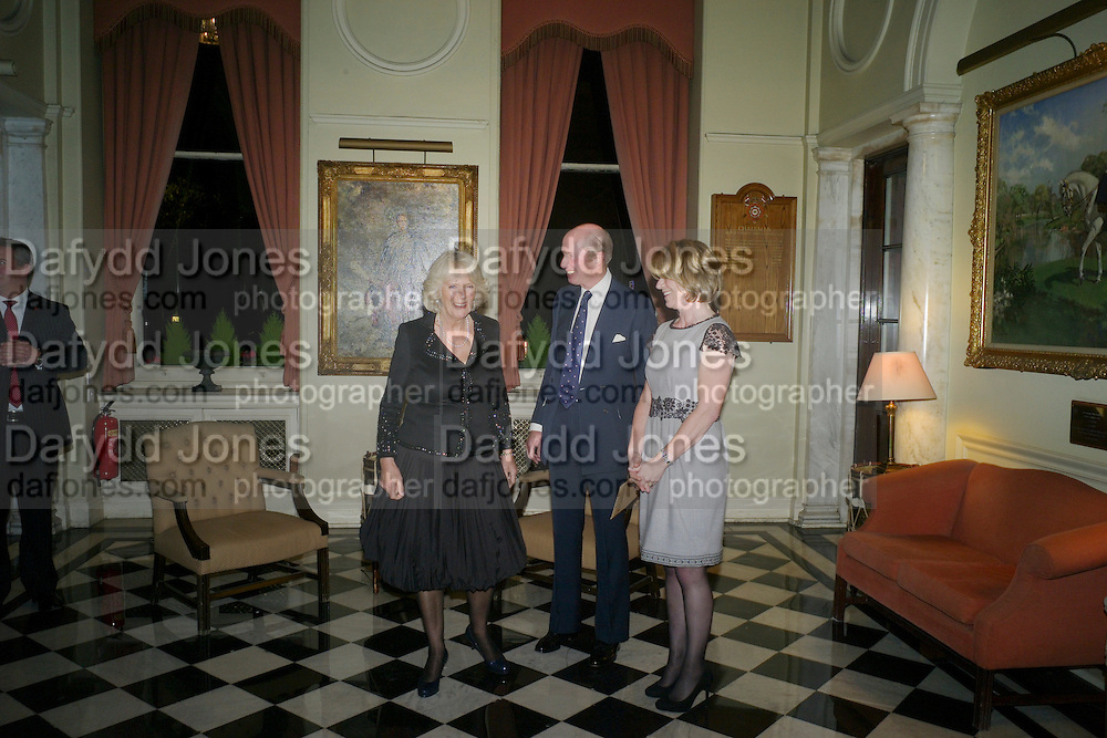 CAMILLA DUCHESS OF CORNWALL; NICK PETO; HENRIETTA CHEETHAM, The Lady Joseph Trust, fundraising party.<br /> Camilla, Duchess of Cornwall  attends gala fundraising event as newly appointed President of the charity. The Lady Joseph Trust was formed in 2009 to raise funds to acquire horses for the UKÕs top Paralympic riders Cavalry and Guards Club, 127 Piccadilly, London,<br /> 26 October 2011. <br /> <br />  , -DO NOT ARCHIVE-© Copyright Photograph by Dafydd Jones. 248 Clapham Rd. London SW9 0PZ. Tel 0207 820 0771. www.dafjones.com.<br /> CAMILLA DUCHESS OF CORNWALL; NICK PETO; HENRIETTA CHEETHAM, The Lady Joseph Trust, fundraising party.<br /> Camilla, Duchess of Cornwall  attends gala fundraising event as newly appointed President of the charity. The Lady Joseph Trust was formed in 2009 to raise funds to acquire horses for the UK's top Paralympic riders Cavalry and Guards Club, 127 Piccadilly, London,<br /> 26 October 2011. <br /> <br />  , -DO NOT ARCHIVE-© Copyright Photograph by Dafydd Jones. 248 Clapham Rd. London SW9 0PZ. Tel 0207 820 0771. www.dafjones.com.