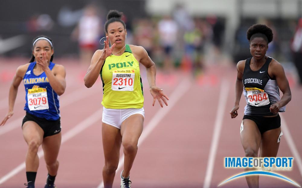 Apr 7, 2018; Arcadia, CA, USA; Ariyonna Augustine (2310) of Long Beach Poly wins the girls 100m in 11.56  during the 51st Arcadia Invitational at Arcadia High. From left: Aliya Wilson (3079) of Tahoma (WA), Ausustine and Aalyiah Wilson (3064) of Stockdale.