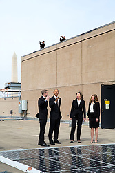 President Barack Obama looks at solar panels with Energy Department engineer Eric Haukdal on the roof of the Department of Energy in Washington, D.C., March 19, 2015. Liz Sherwood-Randall, Deputy Secretary of Energy and Kate Brandt, Federal Environmental Executive, Council of Environmental Quality, right, accompany them. (Official White House Photo by Pete Souza)<br /> <br /> This official White House photograph is being made available only for publication by news organizations and/or for personal use printing by the subject(s) of the photograph. The photograph may not be manipulated in any way and may not be used in commercial or political materials, advertisements, emails, products, promotions that in any way suggests approval or endorsement of the President, the First Family, or the White House.