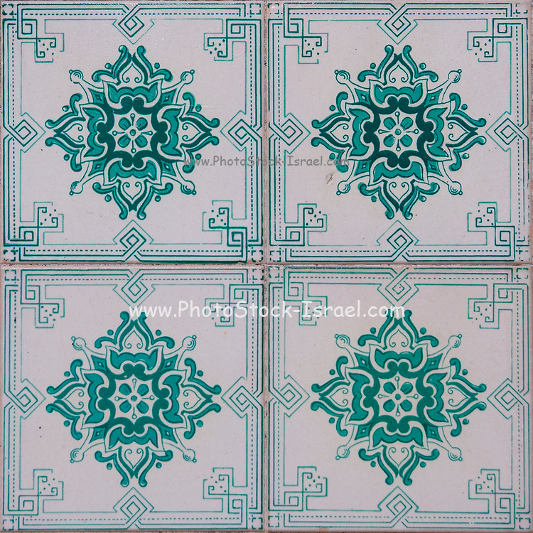 Traditional reen Portuguese seamless ceramic tiles used to decorate the outside walls of houses and buildings. Photographed in Portugal