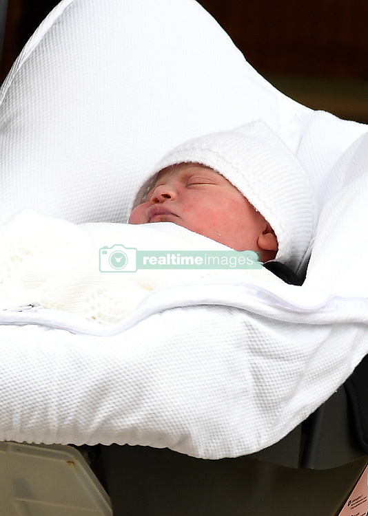 The Duke of Cambridge carries his newborn son in a car seat as he leaves the Lindo Wing at St Mary's Hospital in Paddington, London. Photo credit should read: Doug Peters/EMPICS Entertainment