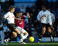 Photo. Chris Ratcliffe, Digitalsport<br /> West Ham United v Derby County. Coca Cola Championship. 23/01/2005<br /> Mark Noble manages to get a shot away despite the attentions of Derby's Inigo Idiakez left and Ian Taylor right.