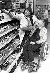 Carer & elderly man shopping UK 1992