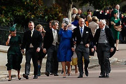 Autumn and Peter Phillips and Zara Tindall and her husband English former rugby player Mike Tindall arrive for the wedding of Princess Eugenie to Jack Brooksbank at St George's Chapel in Windsor Castle.