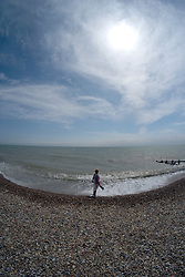 Pevensey Bay, East Sussex UK<br /> Typical English coastal resort with pebble beach and wooden groynes
