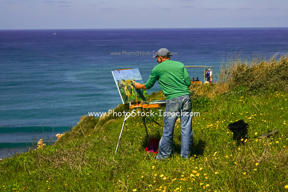 Landscape artist painting on canvas