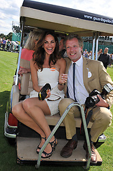 TASHA DE VASCONCELOS MOTA E CUNHA and HUGO BURNAND at the 27th annual Cartier International Polo Day featuring the 100th Coronation Cup between England and Brazil held at Guards Polo Club, Windsor Great Park, Berkshire on 24th July 2011.