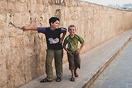 """Two boys tell a photographer, """"You can take our picture if we can take yours."""" The picture they took of me (with my camera) moments later was pretty well done.<br /> <br /> (Aleppo, Syria - June 23, 2010)"""