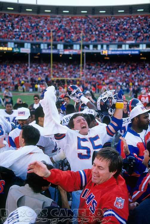 New York Giants players and staff celebrate in the middle of the field after beating the San Francisco 49ers in the NFC championship football game, Sunday, Jan. 20, 1991 at Candlestick Park in San Francisco. The Giants won, 15-13 and now move on to the Super Bowl against the Buffalo Bills. (Photo by D. Ross Cameron)