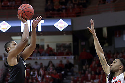 20 March 2017:  B.J. Taylor shoots over Tony Wills(12) during a College NIT (National Invitational Tournament) 2nd round mens basketball game between the UCF (University of Central Florida) Knights and Illinois State Redbirds in  Redbird Arena, Normal IL
