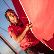 Leg 4, Melbourne to Hong Kong, day 08 on board MAPFRE, Joan Vila paking a sail. Photo by Ugo Fonolla/Volvo Ocean Race. 08 January, 2018.