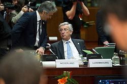 Jean-Claude Juncker, Luxembourg's prime minister, right, speaks with Werner Faymann, Austria's chancellor, during the European Summit meeting at EU Council headquarters in Brussels, Belgium, on Thursday, June 17, 2010. (Photo © Jock Fistick)