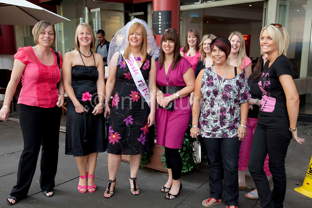 A group of women on a hen party in central London. All dressed up in ink and black the girls are planning a big night ahead.