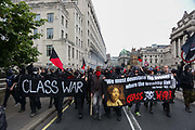A black bloc seperates from the main march. The anti-austerity march, the People's Assembly saw tens of thousands marching and protestin in the streets of London against the newly elected conservative government.