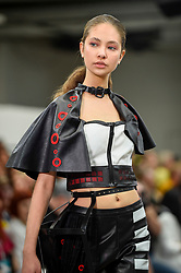 © Licensed to London News Pictures. 02/06/2019. LONDON, UK.  A model presents a look by Celine Constantinides from University of Huddersfield in the GFW Collective show on day one of Graduate Fashion Week taking place at the Old Truman Brewery in East London.  The event presents the graduation show of up and coming fashion designers from UK and international universities.  Photo credit: Stephen Chung/LNP