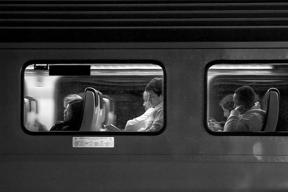 A late train full of commuters looking for some sleep.