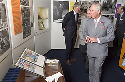 The Prince of Wales, President of The National Trust, looks at Sir Winston Churchill's Nobel Peace prize award as he visits Chartwell House, Kent, the former country home of Churchill which has undergone restoration.