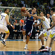 Fenerbahce Ulker's Omer ONAN (L), Roko Leni UKIC (2ndR) and Efes Pilsen's Kerem TUNCERI (C) during their Turkish Basketball league Play Off Final third leg match Fenerbahce Ulker between Efes Pilsen at the Abdi Ipekci Arena in Istanbul Turkey on Tuesday 25 May 2010. Photo by Aykut AKICI/TURKPIX