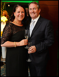 DR Liam Fox and his wife Jesme attend Give Us Time event in London, United Kingdom. Wednesday, 27th November 2013. Give us Time is a charity set up for service personnel to have holidays with their families after tours in War zones. Picture by Andrew Parsons / i-Images