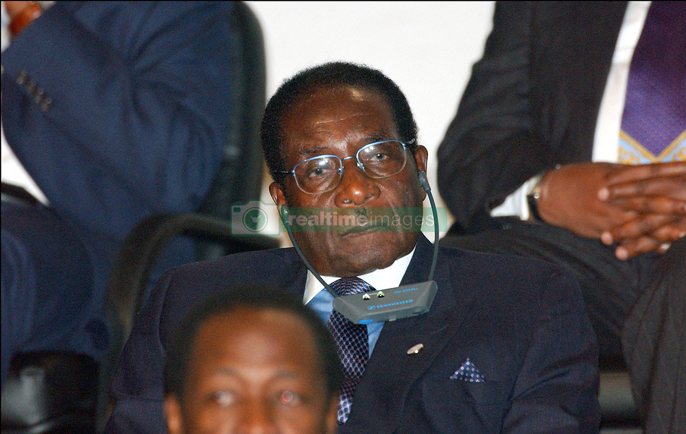 File photo dated february 20, 2003 of Zimbabwean President Robert Mugabe applauds during the first working session of the 22nd Franco-African Summit in Paris, France. Zimbabwe's first post-independence leader Robert Mugabe has died aged 95. He was ousted in a military coup in November 2017, ending three decades in power. He won Zimbabwe's first election after independence, becoming prime minister in 1980. He abolished the office in 1987, becoming president instead. Photo by Giancarlo Gorassini/ABACAPRESS.COM