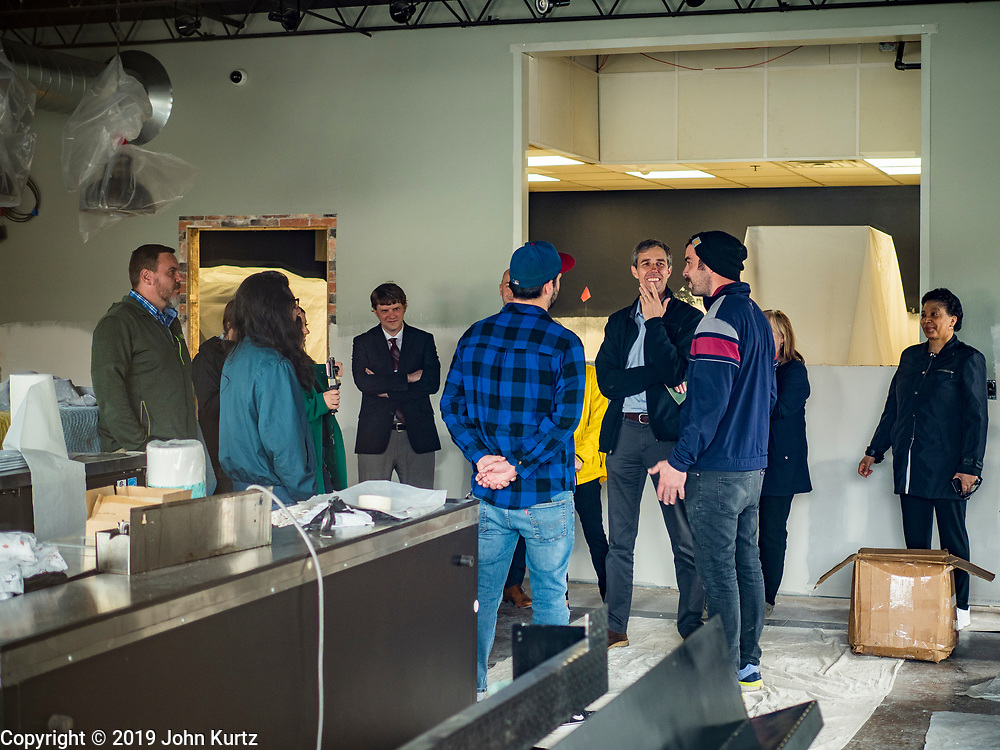 20 MAY 2019 - DAVENPORT, IOWA: BETO O'ROURKE talks to people at LoPiez Pizza about the flood that swept through Davenport. O'Rourke, running to be the 2020 Democratic nominee for the US Presidency, has made climate change a central part of his campaign. He toured flood damage in Davenport Monday. The Mississippi River flooded through downtown Davenport on April 30 and much of downtown is still recovering from the flood.    PHOTO BY JACK KURTZ