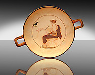 White Ground Kylix from a tomb in Delphi. Athenian 480-470 BC. Apollo depicted crowned in Myrtle Leaves, seated on a stool, with lion claw feet, dressed in a white peoples. In his left hand he has a liar and with his right hand he pours a libation from a naval-phiale. The Crow recalls his mythical love for the beautiful Aigle-Koroni, daughter of King Phlegyas. Delphi Archaeological museum. .<br /> <br /> If you prefer to buy from our ALAMY PHOTO LIBRARY  Collection visit : https://www.alamy.com/portfolio/paul-williams-funkystock/delphi-site-greece.html  to refine search type subject etc into the LOWER SEARCH WITHIN GALLERY.<br /> <br /> Visit our ANCIENT GREEKS PHOTO COLLECTIONS for more photos to download or buy as wall art prints https://funkystock.photoshelter.com/gallery-collection/Ancient-Greeks-Art-Artefacts-Antiquities-Historic-Sites/C00004CnMmq_Xllw