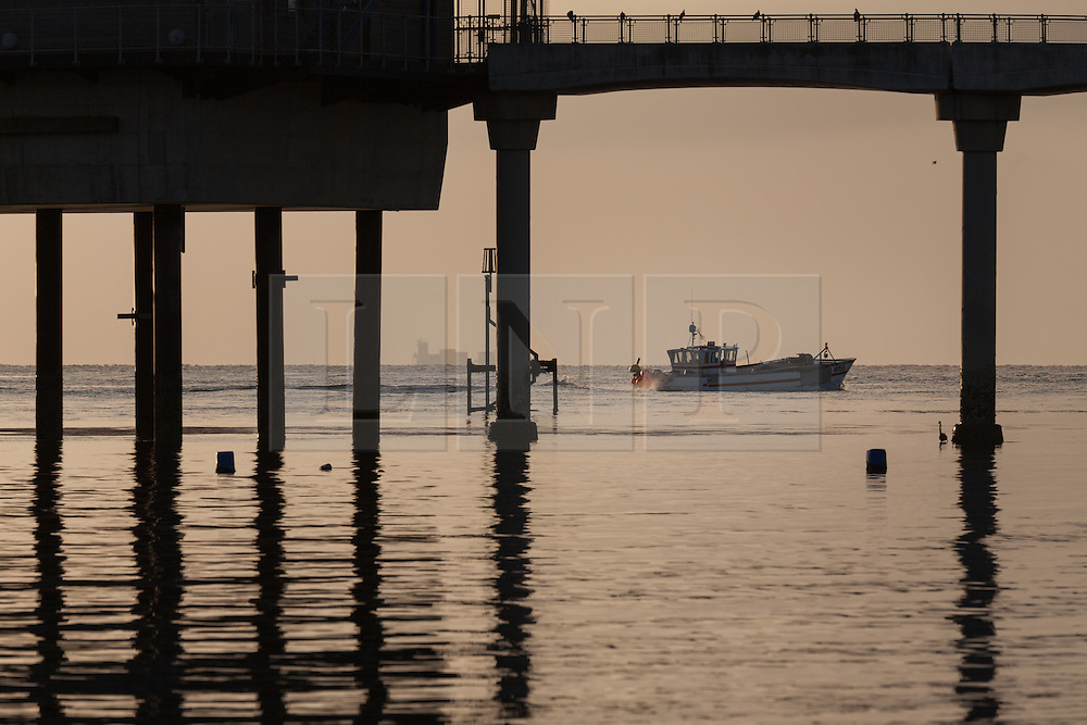 © Licensed to London News Pictures. 22/05/2015. Bembridge, UK. Local fishing boat 'My Way' heading out to begin a day of fishing for crab and lobster at the lifeboat station in Bembridge on the Isle of Wight this morning, Friday 22nd May 2015. The Bank Holiday weekend is set to be warm with sunny spells in the South of England. Photo credit : Rob Arnold/LNP
