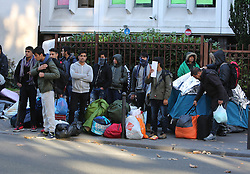"Migrants carry their belongings at a makeshift camp at the Boulevard de la Villette, near the Jaures and Stalingrad metro stations, in northern Paris, France, on October 31, 2016, during a police operation aiming at a future evacuation of the camp. An operation of ""administrative control"" was underway on early October 31 in the Jaures/Stalingrad quarter before a future evacuation, whose date has not yet been set, according to a police source. The makeshift camp on the outskirts of the 10th and 19th arrondissements in the north of the capital numbers today 2,500 people, according to the City of Paris. Photo by Somer/ABACAPRESS.COM"