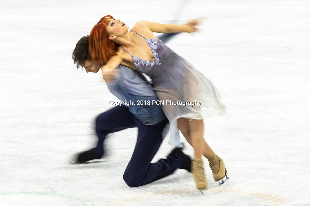 Motion blur action of Tiffani Zagorski/Jonathan Guerreiro (OAR) in the Figure Skating - Ice Dance Free at the Olympic Winter Games PyeongChang 2018
