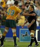 Photo: Richard Lane.<br />New Zealand v Australia. Semi-Final, at the Telstra Stadium, Sydney. RWC 2003. 15/11/2003. <br />Carlos Spencer is concsoled by Matt Cobain