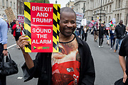 On US President Donald Trumps second day of a controversial three-day state visit to the UK, protesters march down Whitehall and voice their opposition to the 45th American President, down Whitehall, on 4th June 2019, in London England.