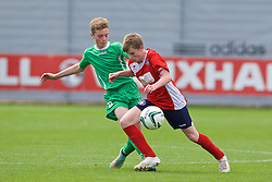 NEWPORT, WALES - Thursday, May 28, 2015: Central WPL Academy Boys' captain Josh Hosie and South WPL Academy Boys' Jamie Apperley during the Welsh Football Trust Cymru Cup 2015 at Dragon Park. (Pic by David Rawcliffe/Propaganda)