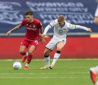 Bristol City's Jamie Paterson (left) under pressure from Swansea City's Jay Fulton (right) <br /> <br /> Photographer David Horton/CameraSport<br /> <br /> The EFL Sky Bet Championship - Swansea City v Bristol City- Saturday 18th July 2020 - Liberty Stadium - Swansea<br /> <br /> World Copyright © 2019 CameraSport. All rights reserved. 43 Linden Ave. Countesthorpe. Leicester. England. LE8 5PG - Tel: +44 (0) 116 277 4147 - admin@camerasport.com - www.camerasport.com