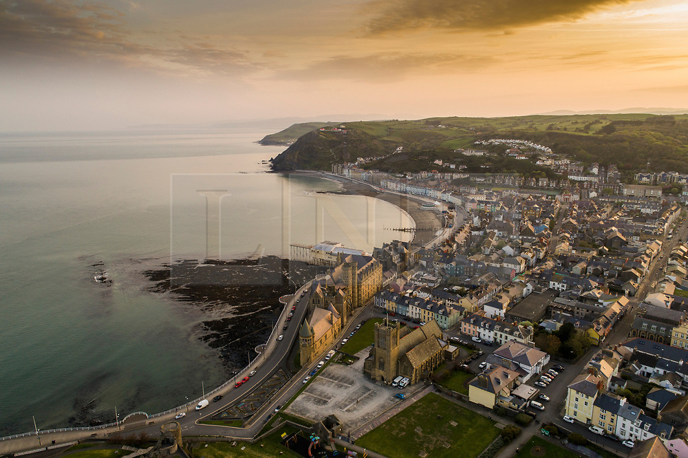 ©Licensed to London News Picture. 20/04/2019 Aberystwyth UK.  Daybreak over  the seaside and university town of Aberystwyth on the west wales coast, at the start of Easter Saturday 2019. The weather is again set to be hot and sunny, with temperatures in the low 20's Celsius (low 70's Fahrenheit). photo credit: Keith Morris/LNP