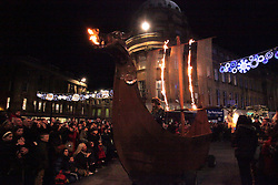 Licensed to London News Pictures. 31/12/2012. Newcastle upon Tyne, UK. Newcastle upon Tyne sees out 2012 with a Winter Carnival procession which attracted around 10,000 specttators and featured a Viking fire longship and fireworks at the Civic Centre. Photo credit: Adrian Don/LNP